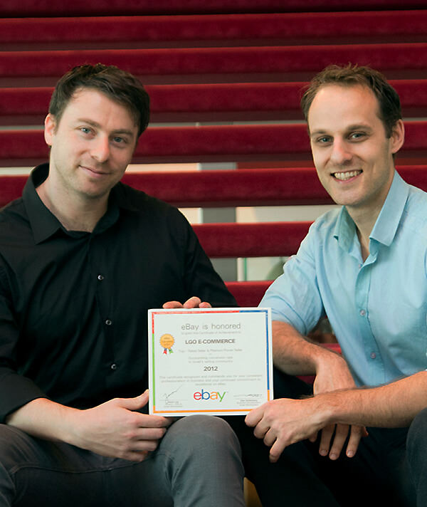 CrazyLister co-founders Max and Victor with the eBay awards for outstanding sales